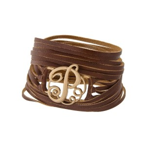 "Brown faux leather wrap bracelet with a gold tone 'P' initial focal. Approximately 22"" in length."