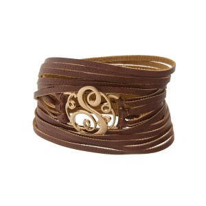 "Brown faux leather wrap bracelet with a gold tone 'S' initial focal. Approximately 22"" in length."