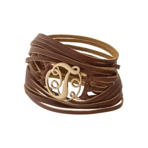 "Brown faux leather wrap bracelet with a gold tone 'T' initial focal. Approximately 22"" in length."