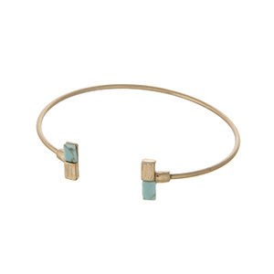Dainty gold tone cuff bracelet with turquoise natural stones.