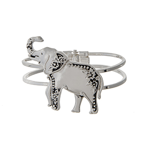 Silver tone hinged bangle bracelet with an elephant focal.