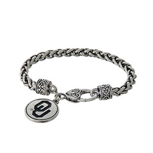 Officially licensed University of Oklahoma silver tone braided bracelet with a lobster clasp and logo charm.