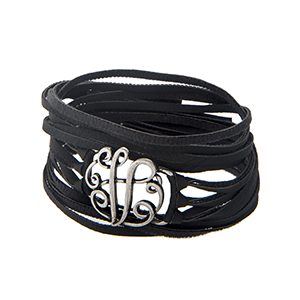 Black faux leather wrap bracelet displaying a silver tone letter 'V' and a snap closure.