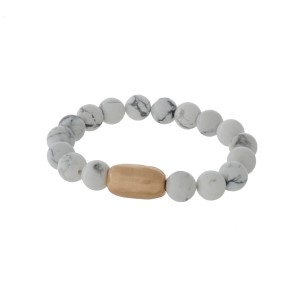 Howlite natural stone beaded stretch bracelet with a hammered gold tone piece.