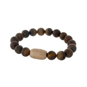 Tiger's eye natural stone beaded stretch bracelet with a hammered gold tone piece.