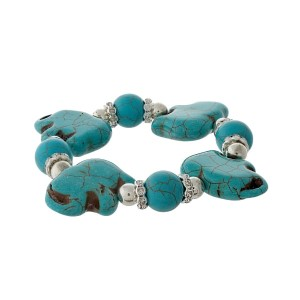 Turquoise beaded stretch bracelet with elephants and silver tone beads.