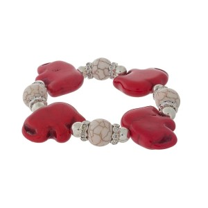 Silver tone stretch bracelet with ivory beads and red elephants.