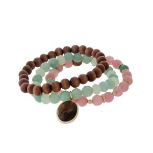 Three piece beaded stretch bracelet with wooden, mint and pink beads.
