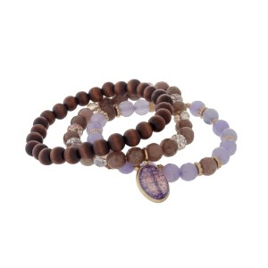 Three piece beaded stretch bracelet with wooden, purple and gray beads.