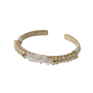 Matte gold tone cuff bracelet with champagne beads and clear chip stones.