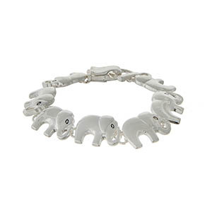 Silver tone magnetic bracelet displaying elephants.