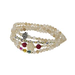 Beige beaded stretch wrap bracelet with an ivory elephant.