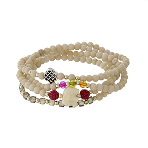Ivory beaded stretch wrap bracelet with an ivory elephant.