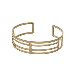 Matte gold tone open cuff bracelet.