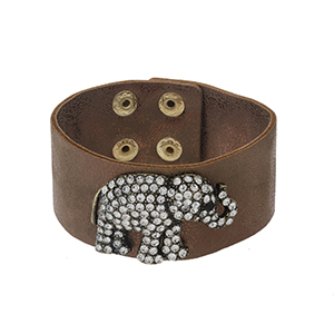 "Bronze faux leather snap bracelet with a pave rhinestone elephant. Approximately 8"" in length."