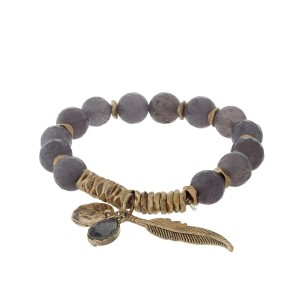 Gray and gold tone beaded stretch bracelet with a leaf charm.