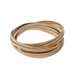 Matte gold tone twisted bangle bracelet.