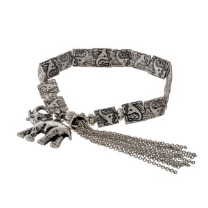 Burnished silver tone stretch bracelet with a stamped elephant design and an elephant charm.