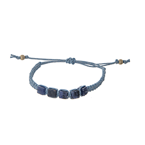 Light blue adjustable bracelet with five sodalite stones.