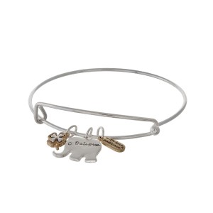 "Silver tone adjustable bangle bracelet with an elephant charm stamped with ""Believe."""