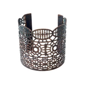 "Copper cuff bracelet with laser cut outs. Approximately 2.5"" in width."