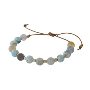 Brown cord adjustable bracelet with aqua and gold beads. Handmade in the USA.