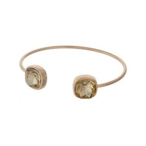 Gold tone cuff bracelet with topaz rhinestones.