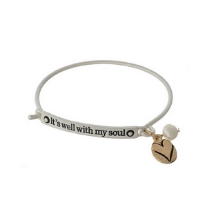 """Silver tone bangle bracelet stamped with """"It's well with my soul"""" and accented freshwater pearl bead."""