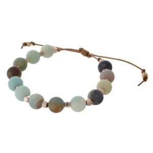 Brown cord adjustable bracelet with matte amazonite and gold stone beads. Handmade in the USA.