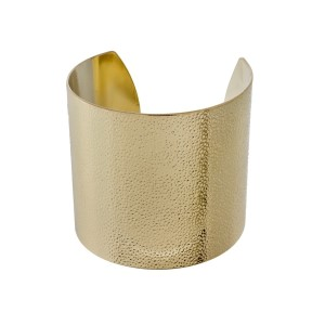 "Textured gold tone cuff bracelet. Approximately 2.5"" in length."