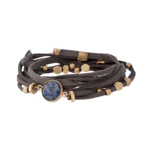 Gray suede wrap bracelet with gold tone beads and a lapis stone.