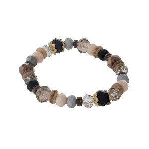 Ivory, gray and bronze beaded stretch bracelet with faceted beads.