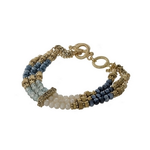 Gold tone, three row toggle bracelet with hematite, gray and iridescent beads.