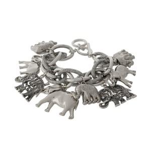 Silver tone link statement bracelet with elephant charms and a toggle closure.