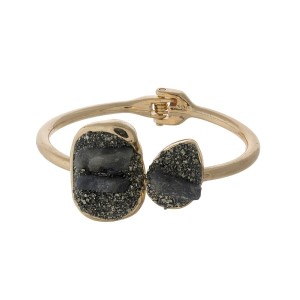 Gold tone hinge bangle bracelet with pyrite and gray stones.