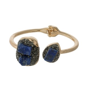 Gold tone hinge bangle bracelet with pyrite and sodalite stones.