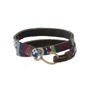 Leather wrap bracelet with multi-colored patterned fabric and a hook closure.