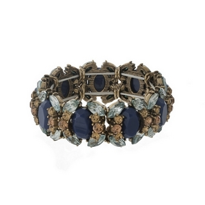 Burnished gold tone stretch bracelet with blue, gray, and topaz rhinestones.