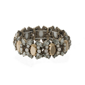 Burnished gold tone stretch bracelet with opal, clear and topaz rhinestones.