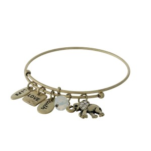 Gold tone adjustable bangle bracelet with an elephant and a white opal bead charm.