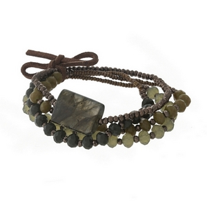 Four piece stretch bracelet set with bronze, hunter green and olive green beads and held together by a suede bow.