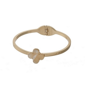 Gold tone, hinge bangle bracelet with an ivory clover focal.
