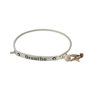 """Silver tone bangle bracelet stamped with """"breathe"""" and accented freshwater pearl bead."""