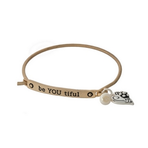 """Gold tone bangle bracelet stamped with """"be YOU tiful"""" and accented freshwater pearl bead."""