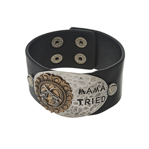 "Black faux leather snap bracelet with a hammered silver tone focal stamped with ""Mama Tried."""