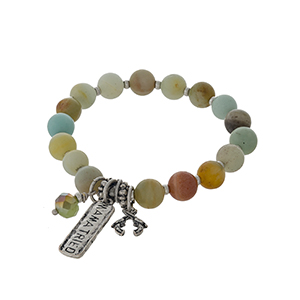 """Silver tone stretch bracelet with amazonite colored beads and a bar charm stamped with """"Mama Tried."""""""