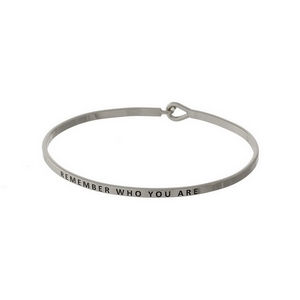 "Silver tone, dainty bangle bracelet stamped with ""Remember who you are."""