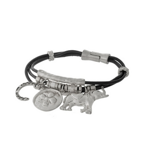 Brown, genuine leather magnetic bracelet with silver tone elephant, clover, and horseshoe charms.