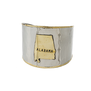 "Two tone, handmade brass cuff bracelet displaying the state of Alabama. Approximately 2"" in width."