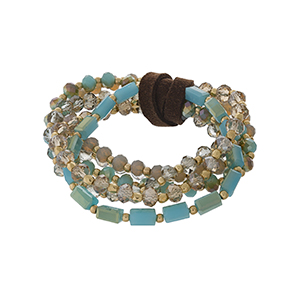 Multi strand stretch bracelet set with turquoise, gray and gold tone faceted beads.